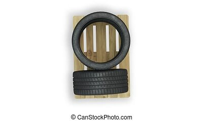 Top view and turning around of Sport Tires put straight on a wood pallet