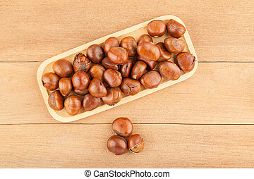 Top view angle of chestnut in wooden plate