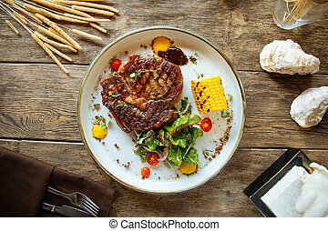 Top view appetizing grilled beef steak with corn