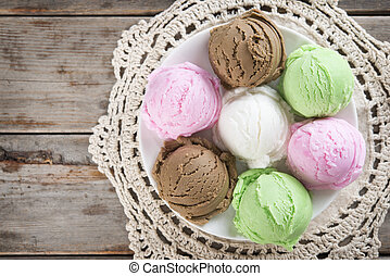 Top view assorted ice cream on wood background.