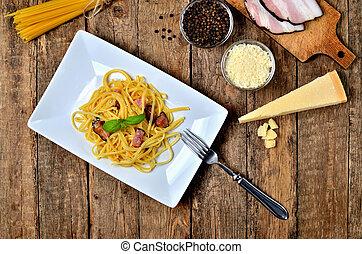Top view at spaghetti Carbonara pasta, with bacon, parmesan cheese, egg. Pasta alla carbonara.