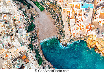 Top view beach of Polignano a Mare on summer day without people
