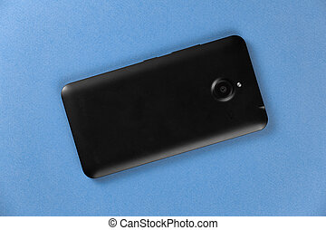 Top view black smartphone on blue background
