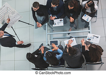 top view. boss at a meeting with the business team
