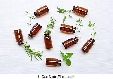 Top view, Bottle of essential oil with herbs