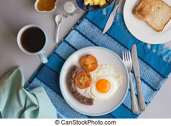 Top view breakfast background with sausage, fried egg,...