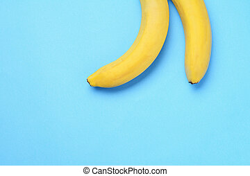 Bunch of bananas on blue background
