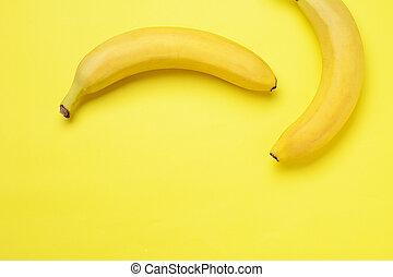 Bunch of bananas on yellow background