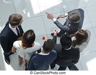 top view. businessman talking to the business team
