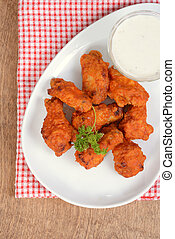 top view chicken wings with sauce