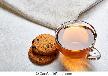 Top view close up picture of glass teacup with biscuits ...