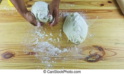 top view closeup on man by hands take part of yeast dough and form small ball