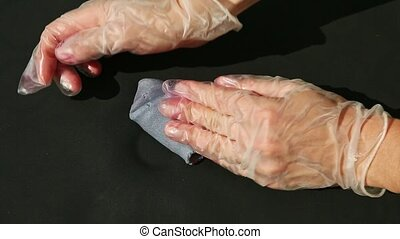 top view closeup woman hands in confectionery gloves knead small piece of violet homemade marzipan mass on black table surface