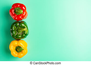 top view colorful bell peppers on blue background