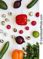 Top view, colorful pattern of healthy food on a white wooden surface. From above, flat lay, overhead.