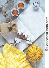 Top view composition with pumpkin, cotton plant flower...
