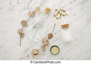 Top view Cosmetic bottle container with eucalyptus on white marble background flat lay. Blank label for branding mock-up Natural beauty product concept