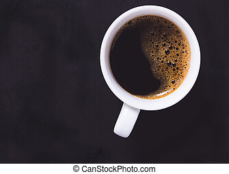 Top view, cup of coffee on black background