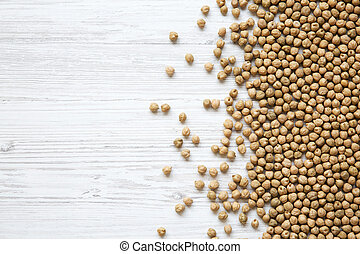 Top view, dried chickpeas on a white wooden background. Copy space.