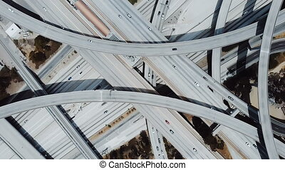 Top view drone rotating fast above big freeway interchange...