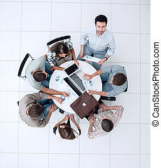 top view. employees work with financial documents