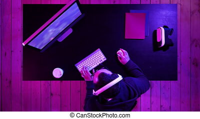 Top view. Evil lough of angry gamer while playing on the computer. Emotional gamer. Professional shot in 4K resolution. 020. You can use it e.g. in your commercial video, medical, business, presentation, broadcast