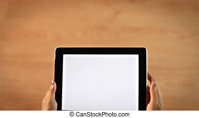 Top view female hands drawing asterick symbol on digital tablet