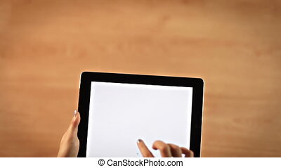 Top view female hands drawing check mark symbol on digital tablet