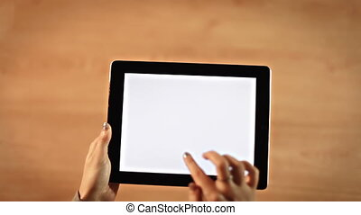 Top view female hands drawing ethernity symbol on digital tablet