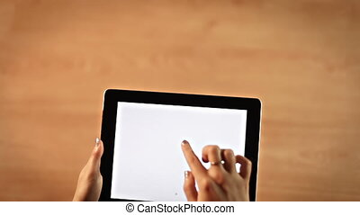 Top view female hands drawing hashtag or number symbol on digital tablet