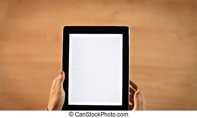 Top view female hands drawing question mark symbol on tablet vertical
