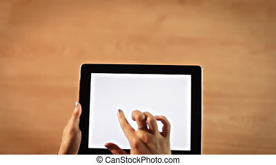 Top view female hands drawing three dots symbol on tablet