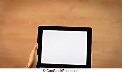 Top view female hands writing A-Z alphabet or encyclopedia symbol on tablet