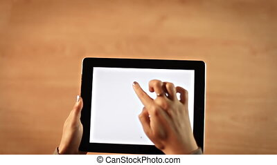 Top view female hands writing B letter on digital tablet