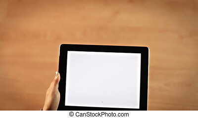 Top view female hands writing C letter on digital tablet