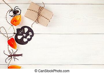 Top view / Flat lay Halloween 's pumpkin and accessories or items spider and gift / present on rustic wooden background. Idea for decoration / ornament to website banner with copy space.