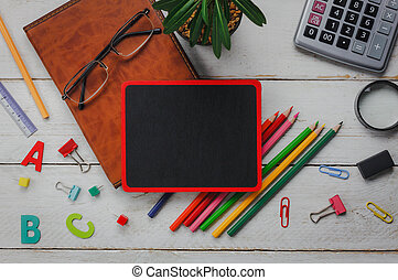 Top view / Flat lay stationery equipment on white wooden table background.
