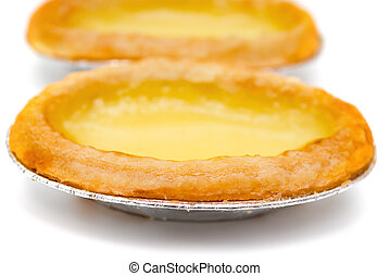 top view fresh egg tarts on a white background close up