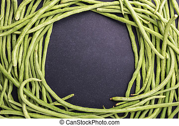 Top view fresh green cowpea or Asparagus bean on black stone background