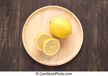 Top view fresh lemons on wooden background