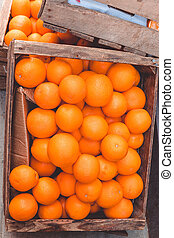 Top view fresh orange citrus fruits in a wooden box