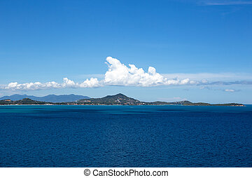 Top view from the cliff of Ko Samui Island with blue sea and white cloud in Thailand.