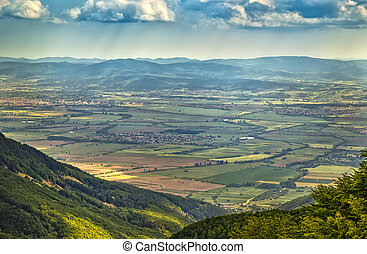 top view from the hill on agricultural fields and small villages