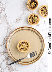 top view fruit crumble tart with a fork