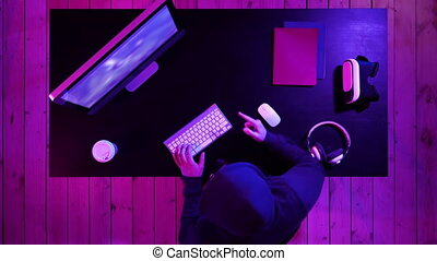 Top view. Gamer cries going crazy of defeat in the video game hitting table with his fist. Professional shot in 4K resolution. 020. You can use it e.g. in your commercial video, medical, business, presentation, broadcast
