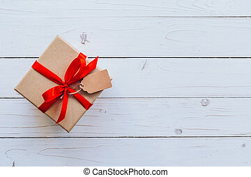 Top view gift box on wood table background with copy space.
