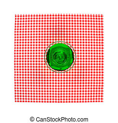 Top view glass with green water on the red tablecloth
