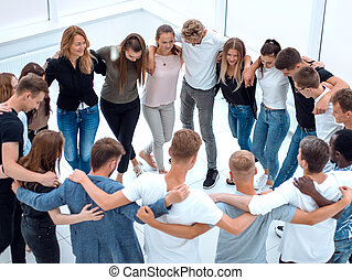 group of casual young people standing in a circle
