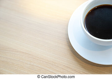 top view half of white coffee cup on wooden table