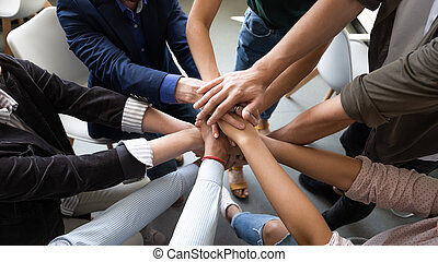 Top view hands stacked together as symbol of teambuilding - ...